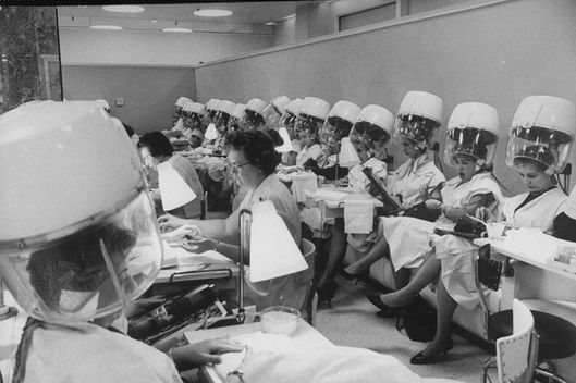 Women under hair dryers after getting hair styled in beauty salon at Saks Fifth Ave. department store.  (Photo by Alfred Eisenstaedt//Time Life Pictures/Getty Images)