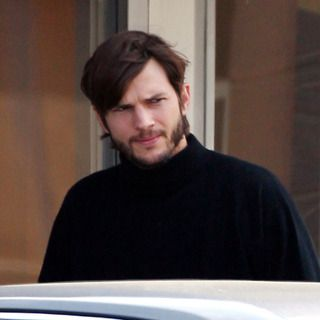 77638, LOS ANGELES, CALIFORNIA - Friday May 11, 2012. **EXCLUSIVE** Ashton Kutcher looks the spitting image of a young Steve Jobs as he grabs a coffee near his home before heading to a film studio. Kutcher is starring as the late Apple honcho in a new biopic that looks to have already started filming. Doing some serious method acting Ashton was really getting into character, sporting long hair, a beard, and the CEO's classic attire of New Balance sneakers, blue jeans, and a black turtleneck sweater and it's not hard to see why the 'Two and a Half Men' actor was chosen for the role. The producer of the film Mark Hulme, using the working title 'Jobs: Get Inspired', has said he chose Kutcher for the role because of his likeness to the Apple co-founder, especially during the period of time the film will cover, the early years of the Apple founder's life from 1971 until 2000. Photograph: Sam Sharma/Miguel Aguilar, ?PacificCoastNews.com **FEE MUST BE AGREED PRIOR TO USAGE** **E-TABLET/IPAD & MOBILE PHONE APP PUBLISHING REQUIRES ADDITIONAL FEES** LOS ANGELES OFFICE:+1 310 822 0419 LONDON OFFICE:+44 20 8090 4079