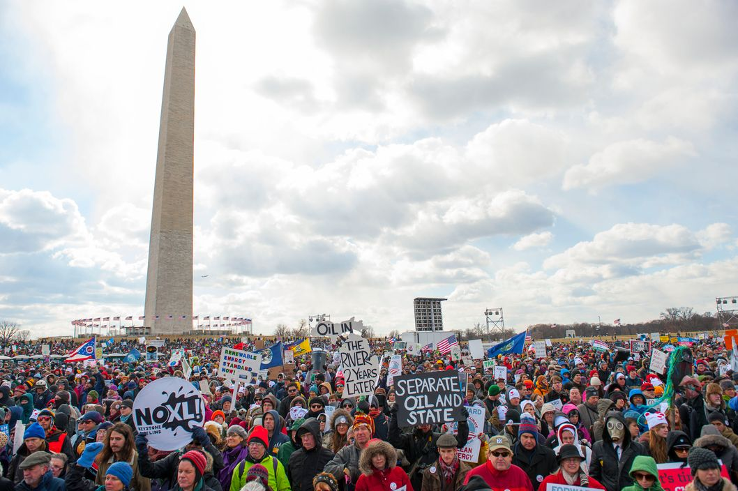 Feb. 17, 2013 - Washington, District of Columbia, U.S. - Tens of thousands march on the National Mall and past the White House to urge President Obama to reject the Keystone XL pipeline and to show leadership on other climate change issues. (Credit Image: ? Jay Mallin/ZUMAPRESS.com)