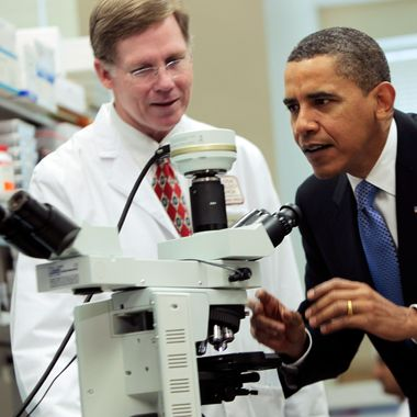 BETHESDA, MD - SEPTEMBER 30:  (AFP OUT)  U.S. President Barack Obama looks at brain cells in a microscope during a tour of a laboratory with Health & Human Services Secretary Kathleen Sebelius (not seen) at the National Institutes of Health September 30, 2009 in Bethesda, Maryland. After the visit, Obama announced five billion USD in grant awards under the American Recovery and Reinvestment Act of 2009 to fund cutting-edge medical research in every state across America.  (Photo by Aude Guerrucci-Pool/Getty Images) *** Local Caption *** Barack Obama