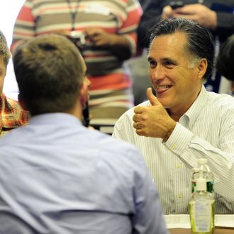 Republican presidential hopeful Mitt Romney gives a thumb up as he joins volounteer to call potential voters at his New Hampshire headquarters in Manchester, New Hampshire, on January 9, 2012. New Hampshire will hold its Republican primaries on January 10, 2012. AFP PHOTO/Emmanuel Dunand (Photo credit should read EMMANUEL DUNAND/AFP/Getty Images)