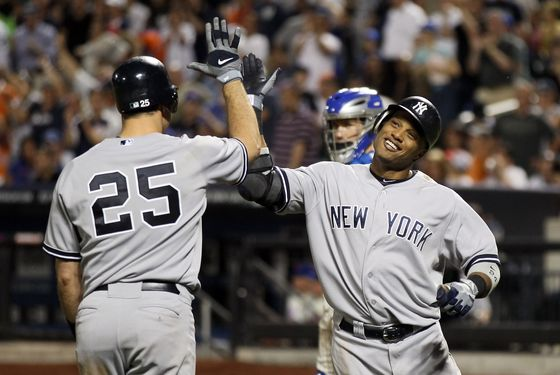 NEW YORK, NY - JUNE 24:  Robinson Cano #24 of the New York Yankees celebrates his home run in the eighth inning with teammate Mark Teixeira in the eighth inning against the New York Mets on June 24, 2012 during interleague play at Citi Field in the Flushing neighborhood of the Queens borough of New York City.  (Photo by Elsa/Getty Images)
