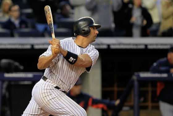 NEW YORK, NY - OCTOBER 02:  Jorge Posada #20 of the New York Yankees hits a triple in the ninth inning against the Detroit Tigers during Game Two of the American League Division Series at Yankee Stadium on October 2, 2011 in New York City.  (Photo by Chris Trotman/Getty Images)