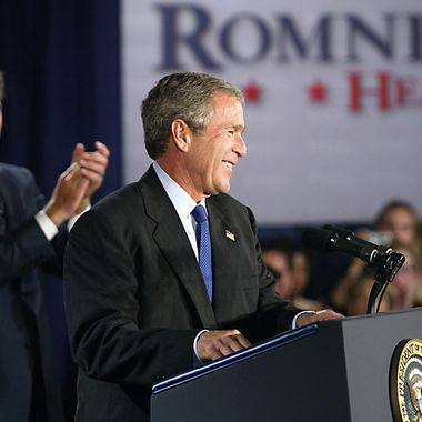 BOSTON, UNITED STATES:  US President George W. Bush (R) addresses a one million USD Republican fundraiser for Massachusetts gubernatorial candidate Mitt Romney (L) at the Seaport Hotel o4 October, 2002 in Boston, Massachusetts. Both Bush and former president Bill Clinton are campaigning in the Bay State as Republicans try to extend a 12-year grip on the governorship of this otherwise Democratic-controlled commonwealth. The office is open because acting Governor Jane Swift, who moved up when Governor Paul Cellucci was named ambassador to Canada, stepped aside for Romney when polls showed he had a far better chance of winning.    AFP PHOTO/TIM SLOAN (Photo credit should read TIM SLOAN/AFP/Getty Images)