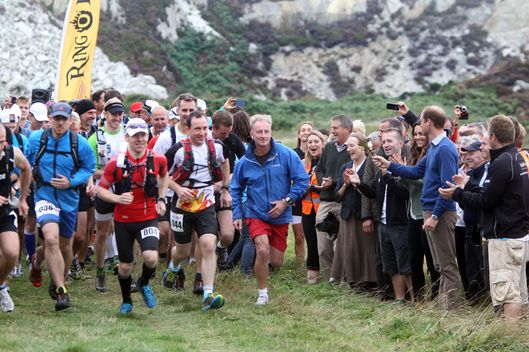 HOLYHEAD, WALES - AUGUST 30:  Catherine, Duchess of Cambridge and Prince William, Duke of Cambridge start  The Ring O'Fire Anglesey Coastal Ultra Marathon on August 30, 2013 in Holyhead, Wales.  (Photo by Paul Lewis - WPA Pool/Getty Images)