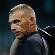Manager Joe Girardi #28 of the New York Yankees waits on the field before the game against the Houston Astros at Minute Maid Park on September 27, 2013 in Houston, Texas.