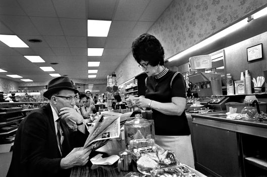 SALTVILLE, VA - JANUARY, 1969: A waitress with a beehive hairdo takes orders at the counter in a drugstore restaurant in Saltville, Virginia. (Photo by Robert Alexander/Archive Photos/Getty Images)