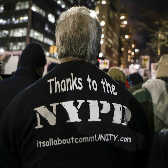 New York, United States. 19th December 2014 -- A man demonstrated outside of City Hall in support of the New York Police Department (NYPD). -- People demonstrating outside of City Hall in New York City against police violence, were met by another group in support of the New York Police Department. Even though the two sides opposed each other, no violence ensued.