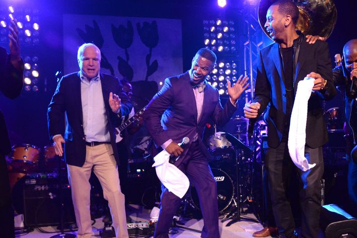 EAST HAMPTON, NY - AUGUST 16: Arizona Senator John McCain and Jamie Foxx dance onstage at Apollo in the Hamptons at The Creeks on August 16, 2014 in East Hampton, New York. (Photo by Kevin Mazur/WireImage)
