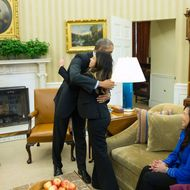24 Oct 2014, Washington, DC, USA --- President Barack Obama hugs Ebola survivor Nina Pham in the Oval Office of the White House in Washington, Friday, Oct. 24, 2014. Pham, the first nurse diagnosed with Ebola after treating an infected man at a Dallas hospital is free of the virus. The 26-year-old Pham arrived last week at the NIH Clinical Center. She had been flown there from Texas Health Presbyterian Hospital Dallas. Pham's mother Diana, center, and sister Cathy Pham watch. (AP Photo/Evan Vucci) --- Image by ? Evan Vucci/AP/Corbis