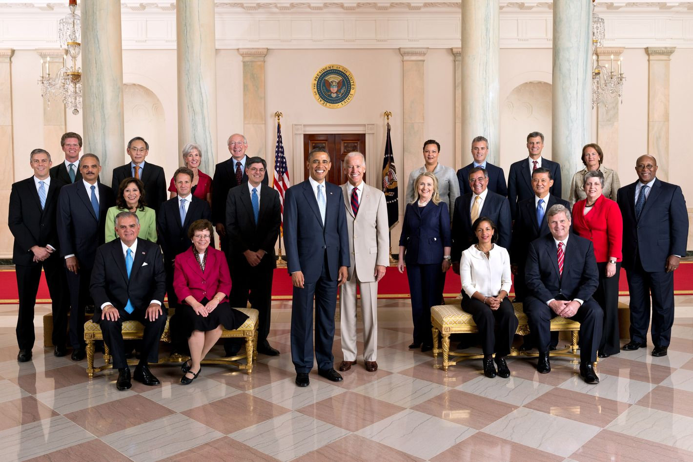 In this handout provided by the White House, U.S. President Barack Obama and Vice President Joe Biden pose with the full Cabinet for an official group photo in the Grand Foyer of the White House, July 26, 2012 in Washington, DC. Seated, from left, are: Transportation Secretary Ray LaHood, Acting Commerce Secretary Rebecca Blank, U.S. Permanent Representative to the United Nations Susan Rice, and Agriculture Secretary Tom Vilsack. Standing in the second row, from left, are: Education Secretary Arne Duncan, Attorney General Eric H. Holder, Jr., Labor Secretary Hilda L. Solis, Treasury Secretary Timothy F. Geithner, Chief of Staff Jack Lew, Secretary of State Hillary Rodham Clinton, Defense Secretary Leon Panetta, Veterans Affairs Secretary Eric K. Shinseki, Homeland Security Secretary Janet Napolitano, and U.S. Trade Representative Ron Kirk.Standing in the third row, from left, are: Housing and Urban Development Secretary Shaun Donovan, Energy Secretary Steven Chu, Health and Human Services Secretary Kathleen Sebelius, Interior Secretary Ken Salazar, Environmental Protection Agency Administrator Lisa P. Jackson, Office of Management and Budget Acting Director Jeffrey D. Zients, Council of Economic Advisers Chair Alan Krueger, and Small Business Administrator Karen G. Mills.