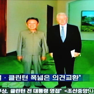 This frame grab from South Korean television taken in Seoul shows former US President Bill Clinton (R) and North Korea's leader Kim Jong-Il posing for a picture in Pyongyang on August 4, 2009. Former US president Bill Clinton arrived in North Korea 4 August on a surprise mission to free two jailed American journalists, the highest-profile visit by an American to Pyongyang for nearly a decade. RESTRICTED TO EDITORIAL USE AFP PHOTO/OFF TV (Photo credit should read OFF TV/AFP/Getty Images)