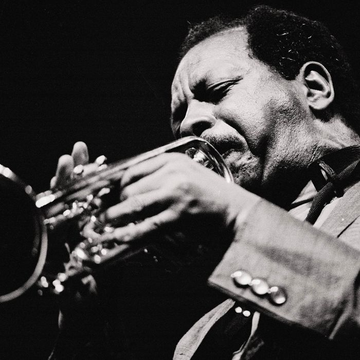 Ornette Coleman, jazz musician Coleman blowing the trumpet