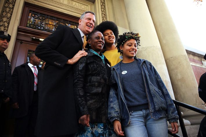 New York Democratic mayoral candidate Bill de Blasio poses with his family, wife Chirlane McCray, son Dante de Blasio and daughter Chiara de Blasio after voting at a public library branch on Election Day on November 5, 2013 in the Brooklyn borough of New York City. De Blasio leads in the polls over his challenger Republican mayoral candidate Joe Lhota by double digit points.