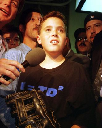 9 Oct 1996: An interviewer speaks to Yankees fan Jeffrey Maier, the twelve year old who caught a fly ball to right field over outfielder Tony Tarasco of the Baltimore Orioles that was ruled a home run in a controversial decision.