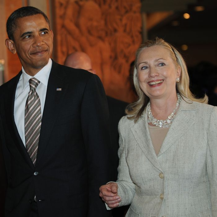US President Barack Obama and US Secretary of State Hillary Clinton arrive for the East Asia Summit in Nusa Dua on Indonesia's resort island of Bali on November 19, 2011 following the Association of Southeast Asian Nations (ASEAN) Summit. The 16-nation East Asia Summit, which already includes China, India and Japan, expanded by two members as US President Barack Obama formally took his seat together with Russia.
