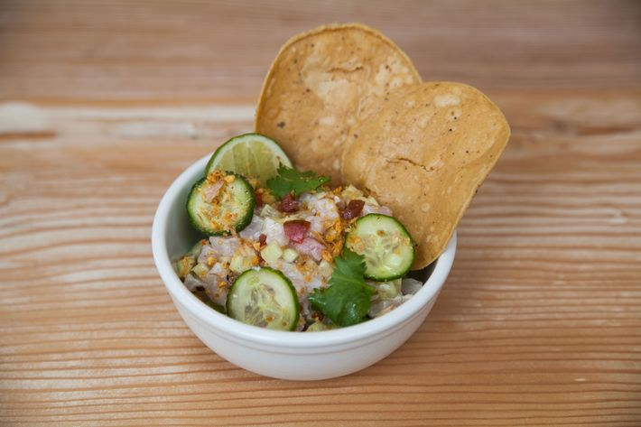 Ceviche with cucumber and tobasco.