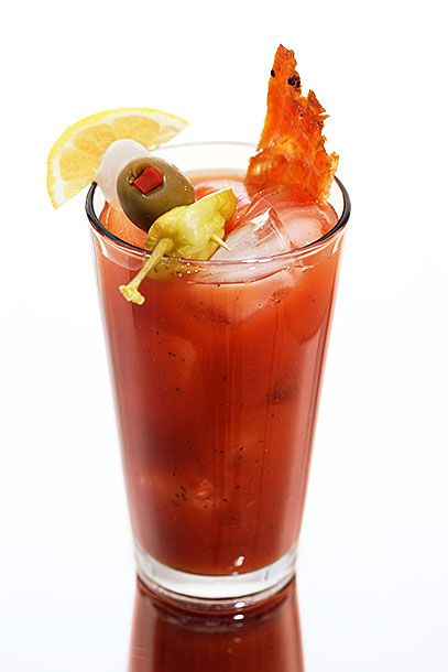"<b>Smoked Salmon Bloody Mary</b>  <i><a href=""http://www.petersburg.org/businesses/dining.html"">Kito's Kave</a>, Petersburg</i>  In New York, bartenders spike Bloody Marys with clam juice and oysters. In Alaska, they use smoked-salmon vodka — the combination is much better than it sounds. Here's just one example: In a pint glass, combine 1 1/2 ounces <a href=""http://www.amazon.com/Alaska-Distillery-Smoked-Salmon-Vodka/dp/B007H36NZO"">smoked-salmon vodka</a>, 4 dashes each Tabasco, Worcestershire sauce, and celery salt, 2 dashes each onion powder and garlic powder, and 8 ounces tomato juice. Add ice to chill, and garnish as Kito's Kave does: a cocktail onion, pepperoncino, lemon wedge, green olive, and a stick of salmon jerky."