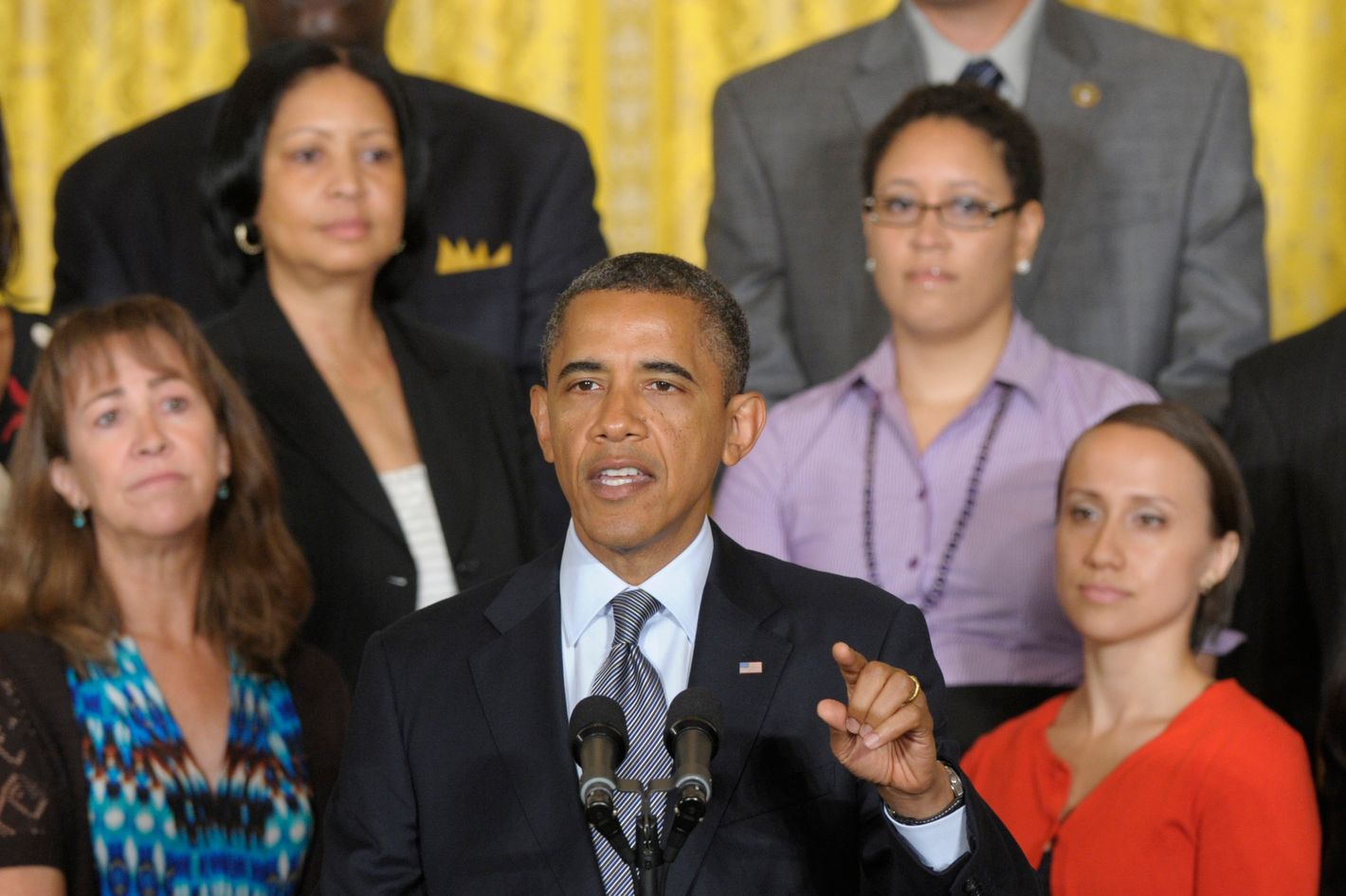 President Barack Obama calls on Congress to pass a temporary, one-year extension of the Bush-era tax cuts for people who make less than $250,000 a year, during a statement in the East Room of the White House in Washington, Monday, July 9, 2012.