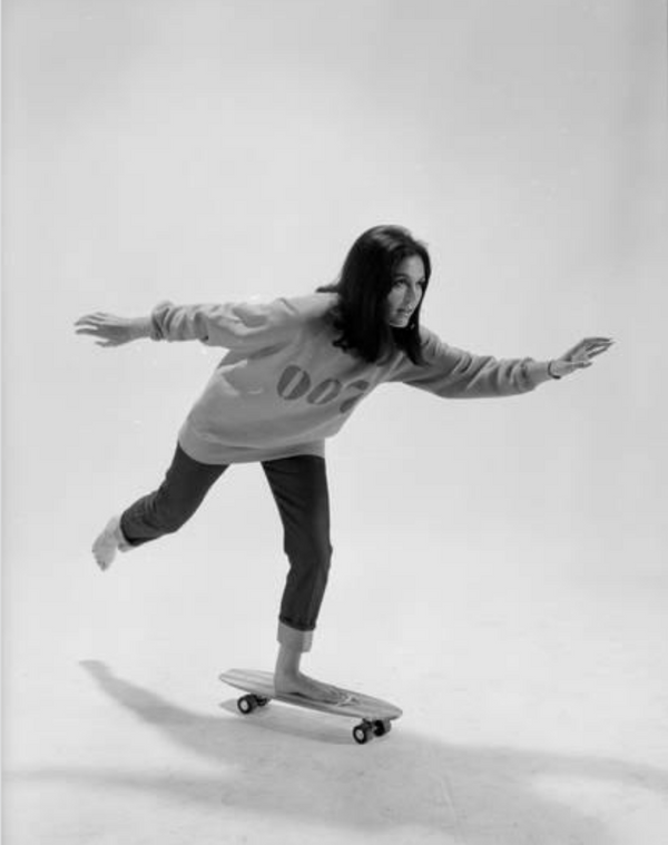 Studio Photos of Gloria Steinem Riding a Skateboard With a 007 James Bond Sweatshirt, 1965