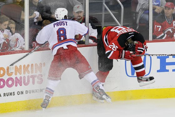 Brandon Prust #8 of the New York Rangers checks Anton Volchenkov #28 of the New Jersey Devils in Game Three of the Eastern Conference Final during the 2012 NHL Stanley Cup Playoffs at the Prudential Center on May 19, 2012 in Newark, New Jersey.