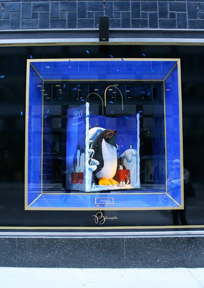 This display features one of the store's shopping bags from 2001 — and a penguin.
