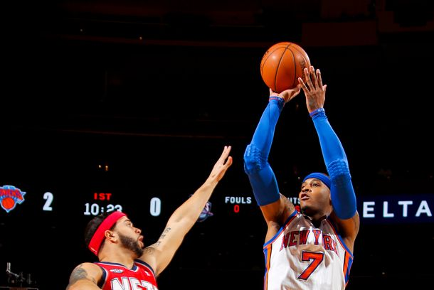 NEW YORK, NY - FEBRUARY 20:  Carmelo Anthony #7 of the New York Knicks shoots over Deron Williams #8 of the New Jersey Nets on February 20, 2012 at Madison Square Garden in New York City.  NOTE TO USER: User expressly acknowledges and agrees that, by downloading and or using this photograph, User is consenting to the terms and conditions of the Getty Images License Agreement. Mandatory Copyright Notice: Copyright 2012 NBAE  (Photo by Nathaniel S. Butler/NBAE via Getty Images)