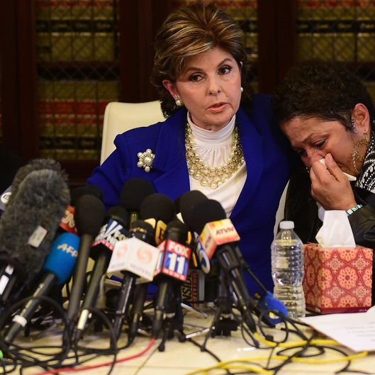 Women's rights attorney Gloria Allred (C) comforts a grieving Chelan (one name) and Helen Hayes (L) during a press conference in Los Angeles on December 3, 2014. Three women who alleged they were victims of the actor spoke to the media.