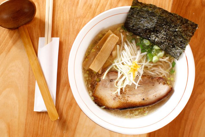 The signature yuzu shoyu ramen with seaweed, bamboo shoots, sliced pork belly (or chicken), and scallion.