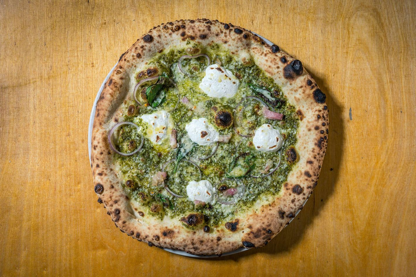 Salsa Verde Gives Trump a Bad Hair Day: pancetta, red onion, ricotta, provolone, chilies, salsa verde.