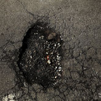 A large pothole sits in a street on February 24, 2014 in the Brooklyn borough of New York City.