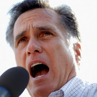 ROCKFORD, IL - MARCH 18: Republican presidential candidate, former Massachusetts Gov. Mitt Romney addresses supporters in an overflow crowd outside the Machine Shed Restaurant March 18, 2012 in Rockford, IL. Romney is campaigning in Illinois three days before that state's primary elections March 21, when 54 GOP delegates are up for grabs. With Romney in the lead on delegates, fellow candidate, former Pennsylvania Sen. Rick Santorum continues to compete for the 1,444 necessary to secure the nomination before the last primary, in Utah on June 26. (Photo by Chip Somodevilla/Getty Images)