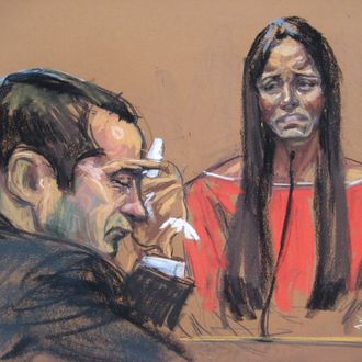 Former New York City police officer Gilberto Valle (L), dubbed by local media as the Cannibal Cop, listens as his wife Kathleen Mangan testifies in this courtroom sketch on the first day of his trial in New York February 25, 2013. Valle and New Jersey mechanic Michael Van Hise are accused of plotting last year to kidnap, cook and eat a Manhattan woman.