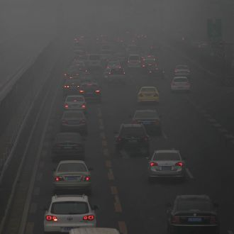 Vehicles drive in heavy smog on a highway near Beijing, China, 29 January 2013.The Ministry of Environmental Protection of China said satellite images showed smog covering an area of 1.3 million square kilometres by 10am on Tuesday, a third more than on Monday and spanning more than 10 municipalities and provinces. Serious air pollution was recorded in northern cities such as Beijing and Shijiazhuang and southern cities such as Wuhan and Chengdu . There was traffic chaos in many regions. The Ministry of Transport said Beijing shut down nine highways. Beijing Capital International Airport reported the cancellation of more than 50 flights. At Xinzheng International Airport in Zhengzhou , Henan, nearly 400 flights had been delayed or cancelled over the past two days.