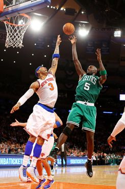 NEW YORK, NY - APRIL 23:  Kevin Garnett #5 of the Boston Celtics shoots against Kenyon Martin #3 of the New York Knicks during Game two of the Eastern Conference Quarterfinals of the 2013 NBA Playoffs at Madison Square Garden on April 23, 2013 in New York City.  NOTE TO USER: User expressly acknowledges and agrees that, by downloading and or using this photograph, User is consenting to the terms and conditions of the Getty Images License Agreement.  (Photo by Al Bello/Getty Images)