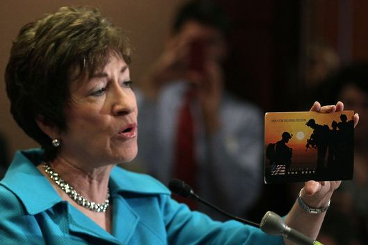 "Sen. Susan Collins (R-ME) holds up an unsigned post card she received from a soldier during a news conference on Capitol Hill on September 20, 2011 in Washington, DC. The news conference was held to mark the end of the Pentagon's ""Don't Ask, Don't Tell"" policy prohibiting gays from serving openly in the military."