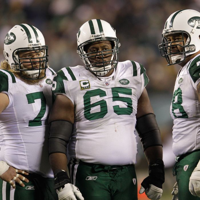 Nick Mangold #74, Brandon Moore #65, and Wayne Hunter #78 of the New York Jets gather in the huddle during the second half of the Jets 45-19 loss to the Philadelphia Eagles at Lincoln Financial Field on December 18, 2011 in Philadelphia, Pennsylvania.