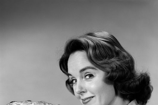 02 Apr 1959 --- 1950s 1960s  woman  smiling holding freshly baked pie looking at camera --- Image by ? ClassicStock/Corbis