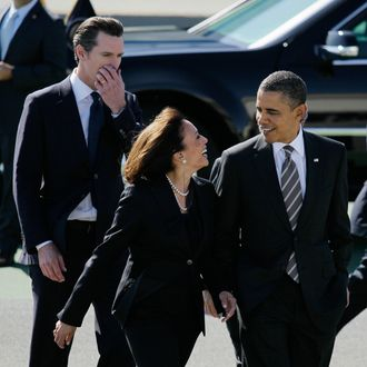 In this Feb. 16, 2012 file photo President Barack Obama walks with California Attorney General Kamala Harris, center, and California Lt. Gov. Gavin Newsom, after arriving at San Francisco International Airport in San Francisco. Obama praised California's attorney general for more than her smarts and toughness at a Democratic Party event Thursday, April 4, 2013. The president also commended Harris for being