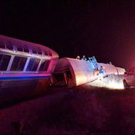 Emergency personnel work on a train that derailed near Dodge City, Kan., Monday, March 14, 2016. An Amtrak statement says the train was traveling from Los Angeles to Chicago early Monday when it derailed just after midnight. (Daniel Szczerba via AP) MANDATORY CREDIT
