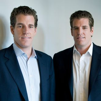 Cameron Winklevoss, left, and his brother, Tyler, stand for a portrait after a television interview in New York, U.S., on Thursday, Oct. 7, 2010. The twin brothers resolved litigation with Facebook Inc. over the creation of the social-networking site in 2008, but have subsequently contested the settlement, claiming they were misled about the value of the site during negotiations. Photographer: Jonathan Fickies/Bloomberg via Getty Images