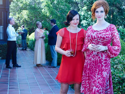Elisabeth Moss as Peggy Olson and Christina Hendricks as Joan Harris - Mad Men _ Season 7B, Gallery _ Photo Credit: Frank Ockenfels 3/AMC