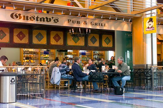 "<a href=""http://gustavs.net/"">Gustav's</a> <i></i>  <i>Concourse C; 503-284-4621</i>   We'll just say it up front: This brewhouse sells growlers of beer to go. Even if that's not enough of a sell (it should be), this casual and cozy German brewhouse is one of the better dining options in an airport actually known for good local-restaurant outposts. They've got juicy rotisserie chicken, crisp schnitzel, and other Saxon fare — not to mention a seasonal beer list and those aforesaid growlers."