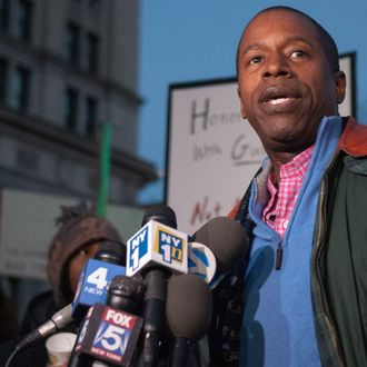 23 Dec 2012, New York City, New York State, USA --- New york, United States. 23rd December 2012 -- New York State Senate Majority Leader Malcolm Smith addresses an anti-gun rally on the Brooklyn Bridge in the wake of a mass shooting at Sandy Hook Elementary School in Newtown, Connecticut. -- Just days before Christmas, in an event called 'Hands Across the Brooklyn Bridge', New York politicians and civil rights activists, lead by civil rights attorney Norman Siegel and New York State Senator Eric Adams, called for tighter gun controls. --- Image by ? Julia Reinhart/Demotix/Corbis