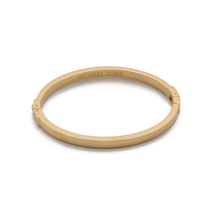 With Its Gold Tone And Satin Finish This Michael Kors Bangle Is The Perfect Addition To Your Bracelet Collection Thin Oblong Shaped Clasp Sleek