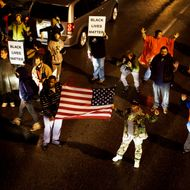 Protestors march through the streets of the Shaw neighborhood of St. Louis, Missouri during the ongoing demonstrations while awaiting the Grand Jury decision on whether or not to indict officer Daren Wilson for the shooting death of 18-year old Michael Brown on November 23, 2014.