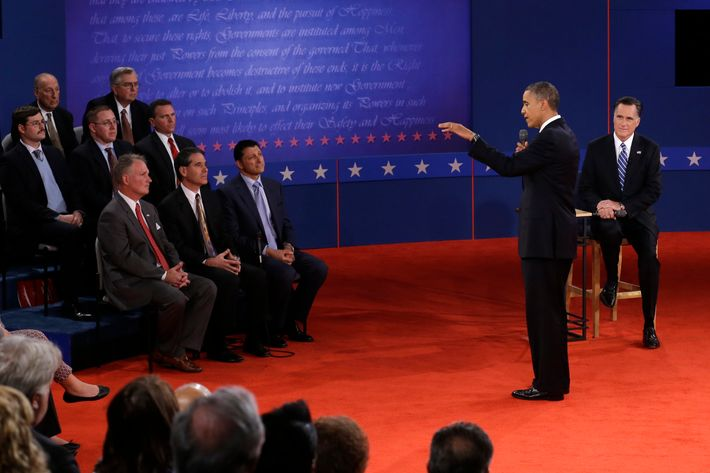 President Barack Obama  answers a question as Republican presidential nominee Mitt Romney  listens during the second presidential debate at Hofstra University, Tuesday, Oct. 16, 2012, in Hempstead, N.Y. (AP Photo/Charlie Neibergall)