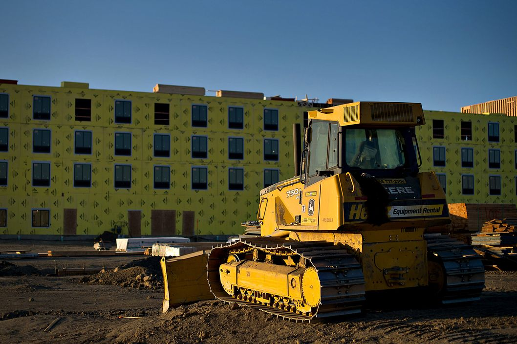 A John Deere Co. 750j crawler dozer sits on the construction site of a Best Western International Inc. hotel in Williston, North Dakota, U.S., on Sunday, Feb. 12, 2012. North Dakota will hold its Republican presidential caucus on March 6. Photographer: Daniel Acker/Bloomberg via Getty Images