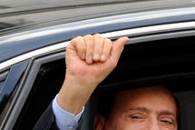 Italian prime minister Silvio Berlusconi waves as he leaves Milan's justice court on September 19, 2011. Italian Prime Minister Silvio Berlusconi was in court in Milan on Monday for a hearing into claims he paid to his former British lawyer David Mills 416,000 euros ($600,000) for false testimony about his business dealings. AFP PHOTO / GIUSEPPE CACACE (Photo credit should read GIUSEPPE CACACE/AFP/Getty Images)