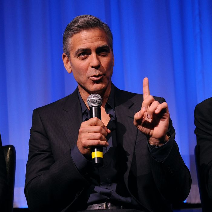 Actor George Clooney attends an official screening of